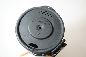 Lid detail with pour spout and strainer.