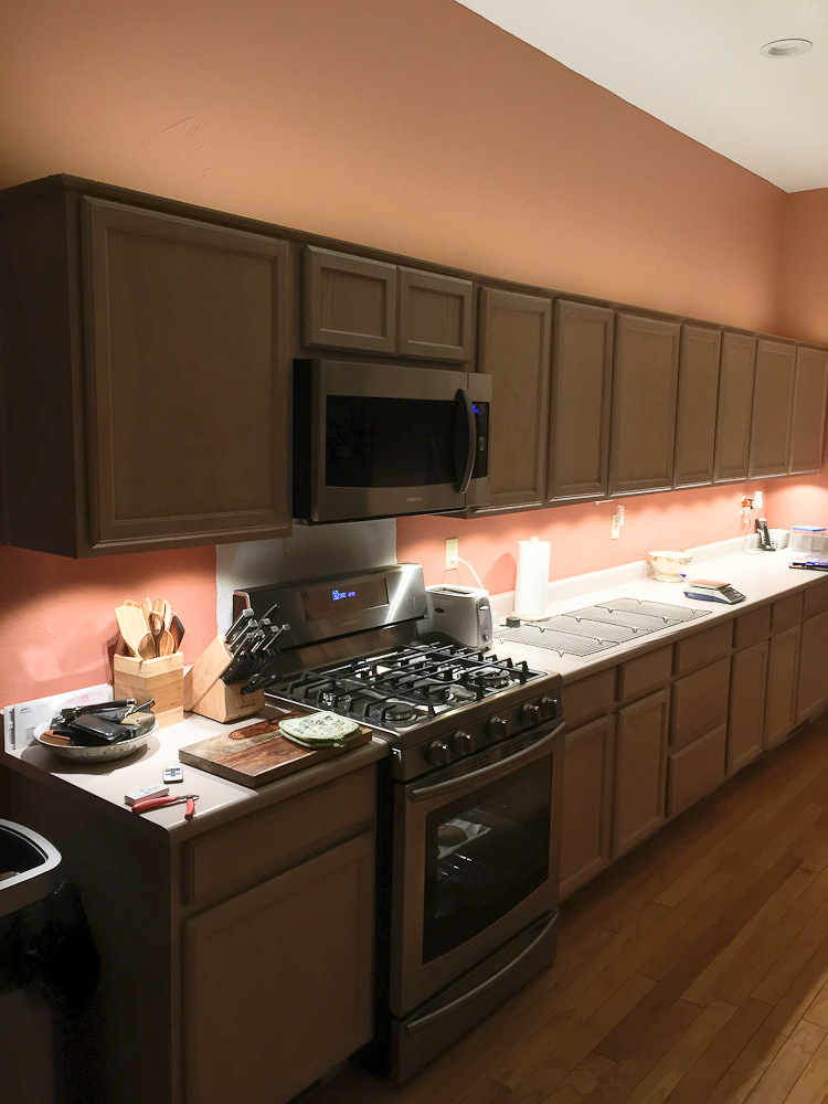 i added a led strip above the cabinets as accent lighting turned out pretty good the above cabinet lights under cabinet are drawing 72 watts and provide above cabinet lighting